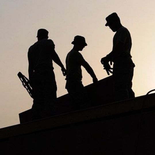 construction workers on the roof